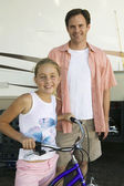 Father with Daughter on Bike — Stock Photo