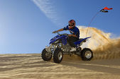 Man riding quad bike — Stock Photo