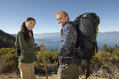 Couple on coastal track — Stock Photo