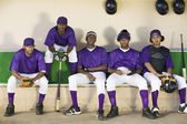 Baseball players sitting — Stock Photo