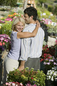 Couple at Plant Nursery hugging — Stock Photo