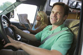 Couple in camper van — Stock Photo