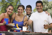 Family at grill — Stock Photo