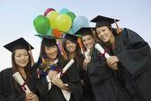 Graduates with Diplomas — Stock Photo