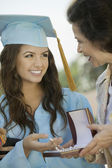 Graduate Receiving necklace from Grandmother — Stock Photo