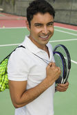 Man with tennis racket and balls — Stok fotoğraf