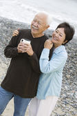 Senior couple at beach — Foto Stock