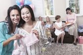 Woman with friend showing off gift — Stock Photo