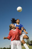 Girls Shoving for Soccer Header — Stock Photo