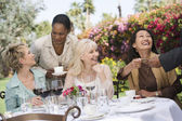 Female friends enjoying dinner — Stock Photo