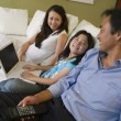 Family Relaxing with Laptop — Stock Photo