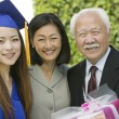 Stock Photo: Graduate with mother and grandfather