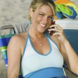 Woman Using Cell Phone on Beach — Stock Photo