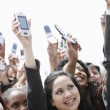 Crowd holding up cell phones — Stock Photo #33810157