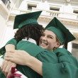 Graduates Hugging — Stock Photo #33810197