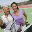 Female Tennis Players with trophy — Stock Photo