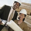 Surveyors with blueprint — Stock Photo