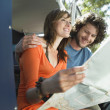 Couple reading map during road trip — Stock Photo #33819763