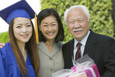 Graduate with mother and grandfather — Stock Photo