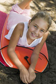 Girl Lying on Boogie Boards — Stock Photo
