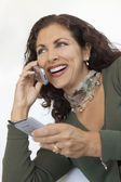 Woman Using Cell Phone and PDA — Stock Photo
