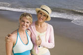Mother and daughter on beach — Stock Photo