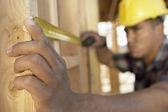 Worker measuring between boards — Stock Photo