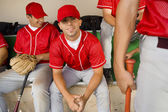 Baseball team-mates in dugout — Stock Photo