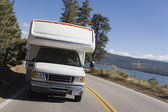 RV driving on mountain road — Stock Photo