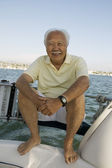 Senior man on sailboat — Stock Photo