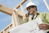 Construction worker with cellphone — Stock Photo