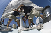 Sailors During Yacht Race Raising Sail — Stock Photo