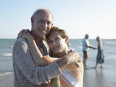 Couple embracing on beach — Stock Photo