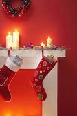 Christmas stockings over fireplace — Stock Photo
