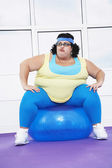 Woman Sitting on Exercise Ball — Stock Photo