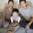 Couple with son Watching Television — Stock Photo