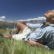 Man lying in field feeling sun — Stock Photo #33821017
