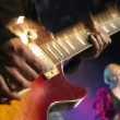 Rock Guitarist on stage — Stock Photo