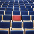 Red Seat in group of blue — Photo