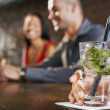 Couple sitting at bar cocktail glass — Stock Photo #33821671