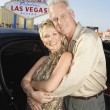 Couple in front of welcome to Las Vegas sign — Stock Photo