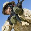 Stock Photo: Soldier aiming through gunsight