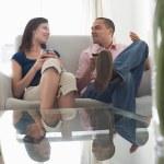 Couple drinking wine talking on sofa — Stock Photo #33822459