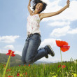 Woman jumping in meadow — Stock Photo