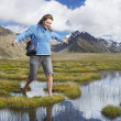 Womwalking through pond — Stock Photo #33823197