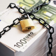Stack of Euros secured by padlock — Stock Photo #33823631