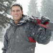 Man holding skis — Stock Photo