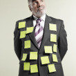 Businessman Wearing Sticky Notes — Stock Photo