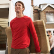 Moving Couple Carrying Sofa — Stock Photo