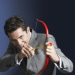 Man aiming toy bow and arrow — Stock Photo #33824233